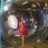 Dancer in a Bubble                  A spectacle! Place one of our dancers or models in this large bubble to create an excellent photo op! Great as a snow globe or for a water themed event!