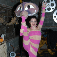 Cheshire Cat Our contorting cheshire cat is available as a strolling entertainer, or for stage shows! Our cat is also part of our Alice in Wonderland production!