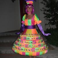 Lollipop Dress This colourful custom creation holds 275 lollipops or wrapped cake pops! Its bright and colourful! Always a hit and an excellent photo op!